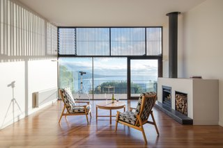 Snowdon calls the design of the entire house a collaborative process with the clients, who actually recycled a good deal of furniture from their previous beach house, such as the coffee table and arm chairs seen here