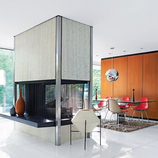 Built in 1957, Witthoefft House was designed and lived in by the architect Arthur Witthoefft. At the time, he was an architect in the Manhattan office of corporate modernists Skidmore, Owings & Merrill. This recently restored 1957 modernist masterpiece features a freestanding travertine-and-steel fireplace, open on all four sides, that divides the living and dining areas.