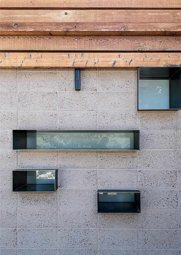 """Exterior, Concrete Siding Material, Metal Siding Material, and Wood Siding Material """"It's like an oasis—we never had privacy before."""" —Amy Bancroft, resident  Photo 11 of 19 in A Forest Sanctuary Designed to Support Autistic Triplets, Their Parents, and a Host of Caregivers"""