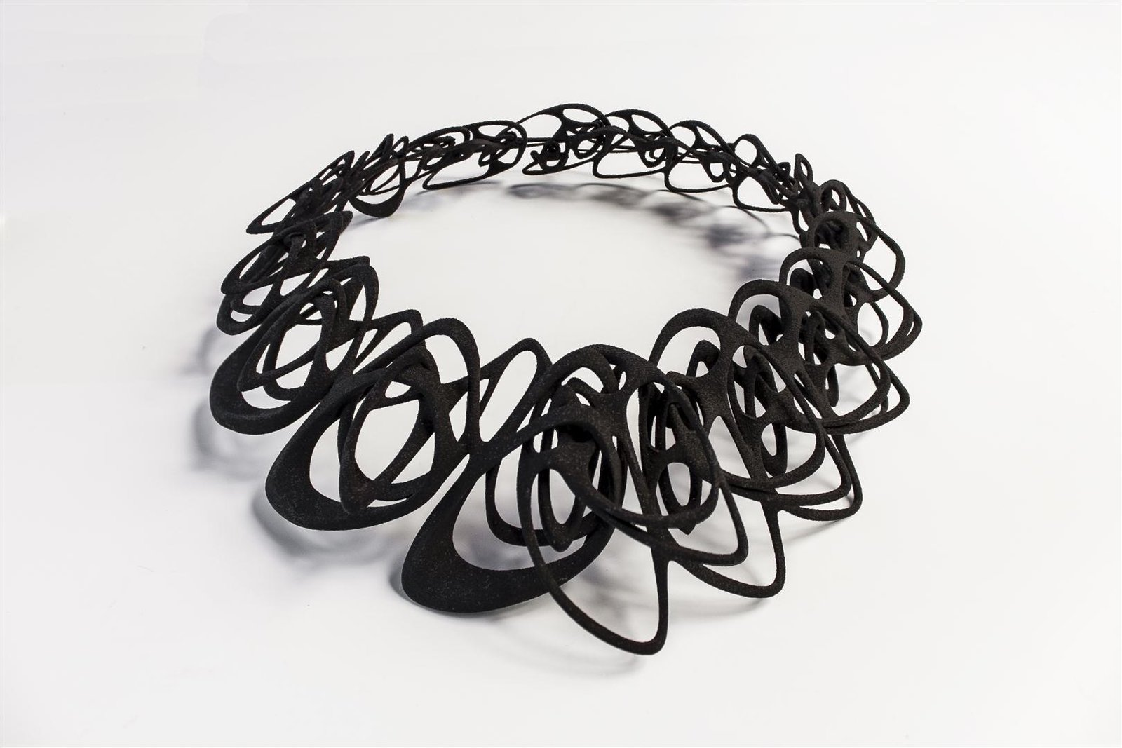 """The flexible nylon that makes up the Catena necklace has a distinct shimmer to it. """"I ended up using SLS [selective laser sintering; a common 3-D process] polished nylon for all of the smaller jewelry pieces, like earrings and rings, and SLS flexible nylon for the necklaces,"""" says Wu.  Photo 1 of 5 in Stunning Modern 3-D Printed Jewelry"""