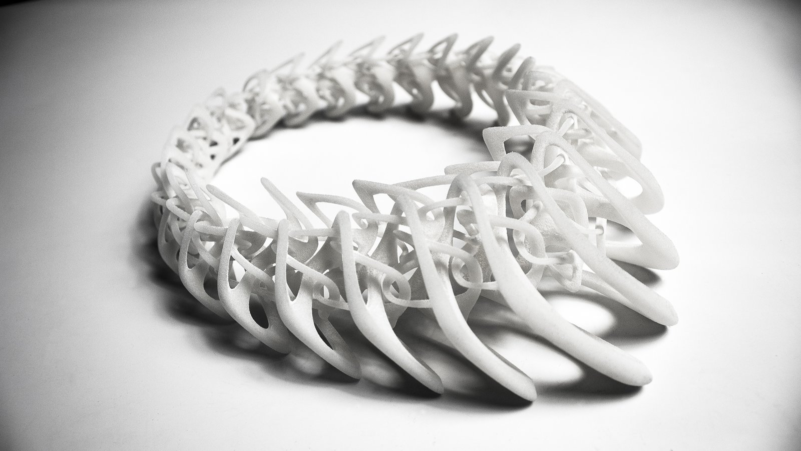 The Tangens necklace, shown in white, has a smooth, bonelike quality.  Photo 3 of 5 in Stunning Modern 3-D Printed Jewelry