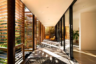 In a Miami residence designed by Melissa and Jacob Brillhart, horizontal louvers on exterior shutters filter daylight while still creating a shaded indoor/outdoor area.
