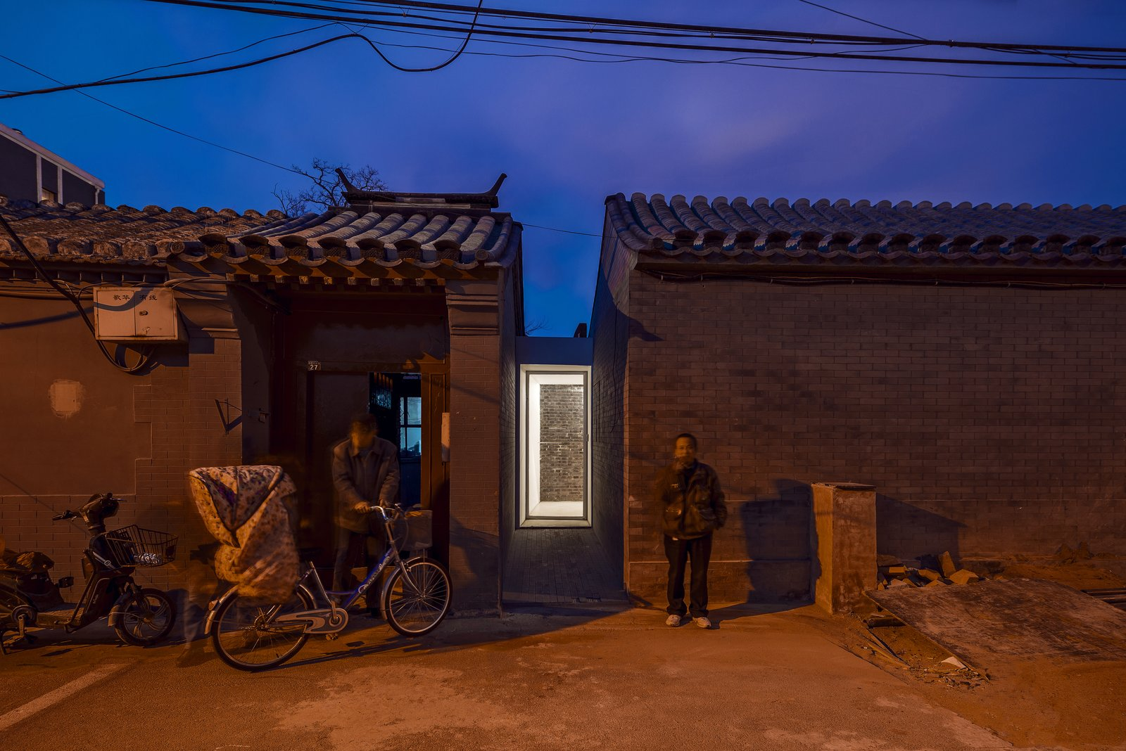 Visitors enter the tea house though a hutong, the narrow street for which these historic neighborhoods are named.  Photo 1 of 7 in An Historic Beijing Structure Gets a Modern Makeover