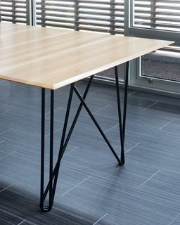 Reclaimed wood is a recurring feature of Hufft's furniture. The Wright Wing dining table is pictured.