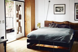 Mad Men star Vincent Kartheiser decided to go small, buying and moving into a 580-square-foot cabin. Here, a curtain slides across for privacy, but the home's masterstroke is a bed that descends from the ceiling. The pulley system that controls the hanging bed needed some serious hardware, including a 300-pound steel counterweight that's hidden in a corner of Kartheiser's closet.