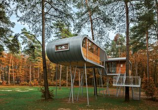 Treehouse by Baumraum, Belgium<br><br>Andreas Wenning's firm Baumraum counts over 40 houses, sited in both rural and urban locales, in its portfolio. To reduce impact at this forested site, Baumraum prefabricated a treehouse and craned it atop 19 steel columns, arranging it so that the surrounding trees' roots wouldn't be harmed.