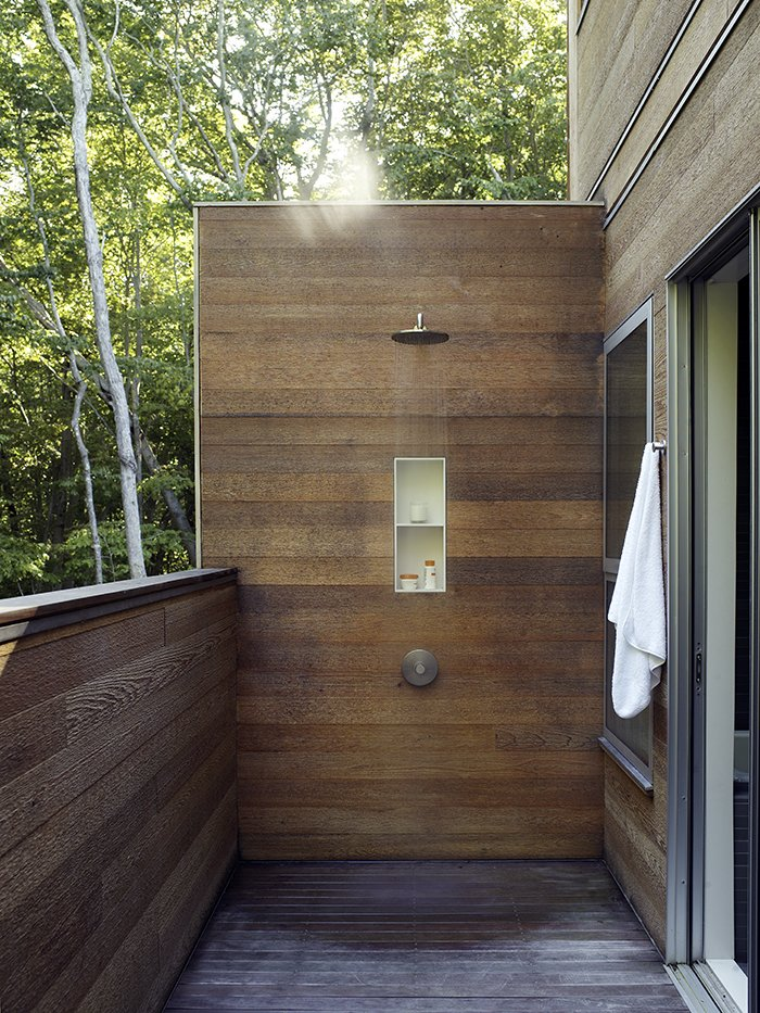 A wood-lined outdoor shower adds a modern touch to one of the decks. Tagged: Outdoor and Shower Pools, Tubs, Shower.  Outdoor by Suze from Art-Filled Hamptons Vacation Home