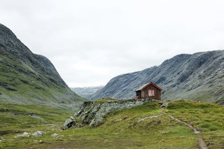 """Anka Lamprecht and Lukas Wezel shared their rustic domicile in a valley in Grotli, Norway. Boasting an enviable view, it's the first cabin archived in the book's """"Backcountry"""" category that features homesteads in the wilderness."""