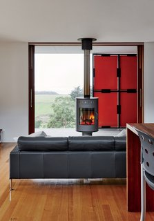 The fireplace, by Rais, can rotate in different directions for both indoor and outdoor use.