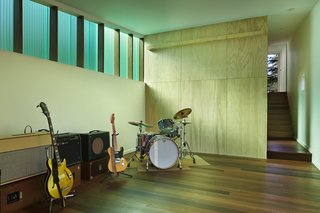 "The 1,000-square-foot studio includes a wood shop and music room. The Red Balau wood flooring was treated with Osmo color oil and Osmo Polyx finish. The walls are painted ""white heron"" by Benjamin Moore."