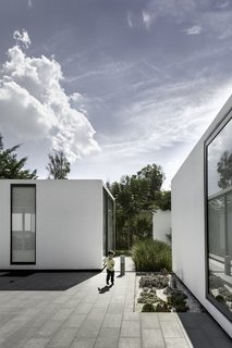 """A Minimalist Mexican Retreat Uses an Array of Strategies to Beat the Heat - Photo 2 of 7 - The project title """"Casa 4.1.4"""" refers to the four main volumes, one central plaza, and four patios. This simple configuration creates distinct, private spaces tied together with open-air common areas."""