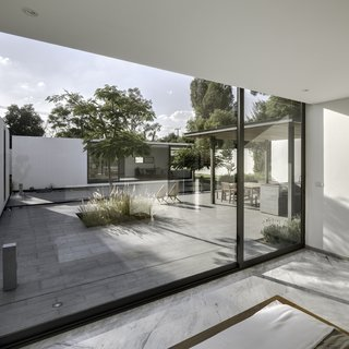 A Minimalist Mexican Retreat Uses an Array of Strategies to Beat the Heat - Photo 5 of 7 - The interior marble flooring and exterior granite surfacing blend well to complement the spare white modules. Both materials were chosen with climate in mind: granite because it both absorbs less heat and is easy to clean, marble because it cools down the interior.