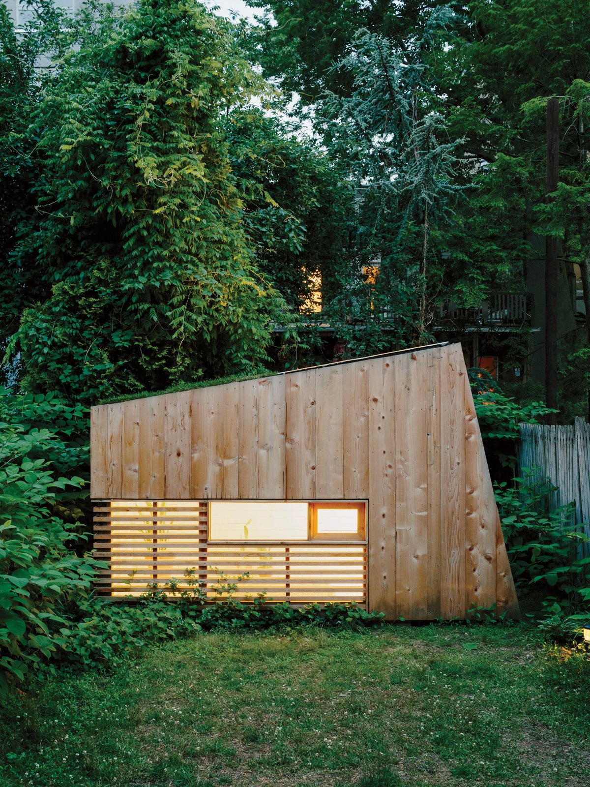 "Architect Nicholas Hunt used his garden as a laboratory for his budding private practice, creating a 55-square-foot studio filled with handcrafted details, including a half-inch reveal surrounding the front window and a Plexiglas skylight. ""When a place is this small, the minimal details need to be nice,"" Hunt says.  Photo 2 of 6 in An Architect Builds His Own Backyard Oasis From Salvaged Materials"