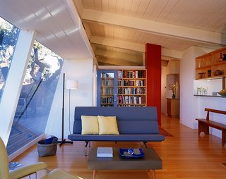 """20 Great Midcentury Modern Interiors - Photo 18 of 20 - Buttrick pays homage to the home's midcentury bones with an Eames """"Sofa Compact."""" When asked to describe the interior aesthetic, the architect explained that it very much embodies most Eamesian principles of design."""