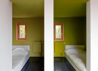 The pared-down aesthetic of the children's bedrooms lets their chartreuse walls pop.