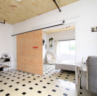 Photo of the Week: Simple Sliding Door Made of Spare Plumbing Parts