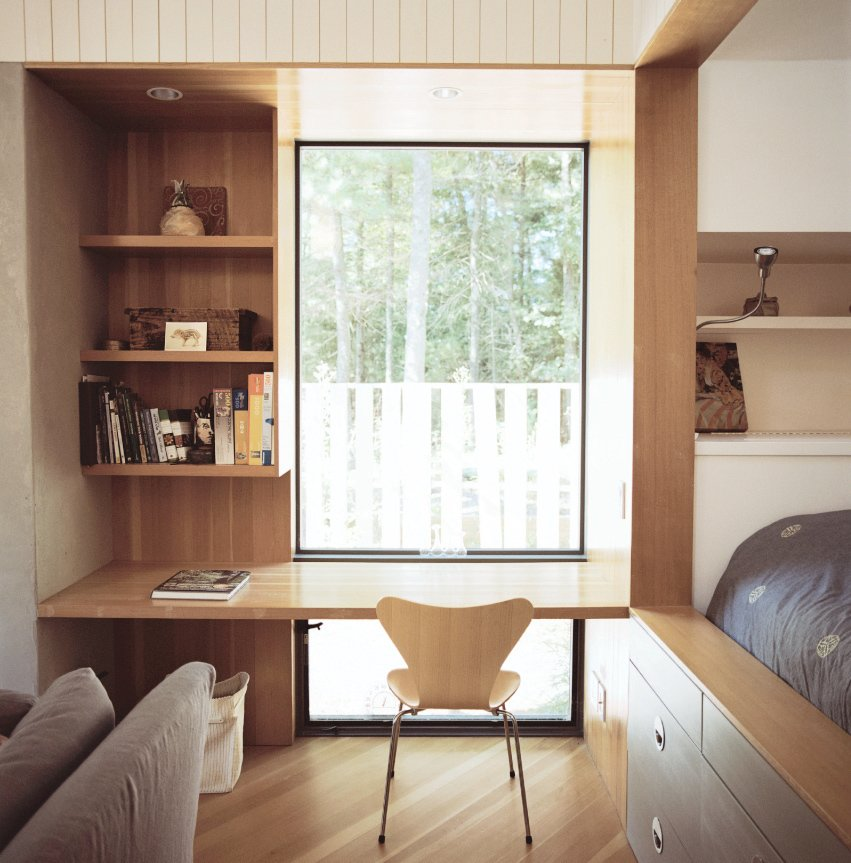 Office, Chair, Desk, and Medium Hardwood Floor A writing desk is paired with a classic Series 7 chair by Arne Jacobsen.  Photo 10 of 12 in This Tiny New England Cottage Is a No-Frills Weekend Hideaway