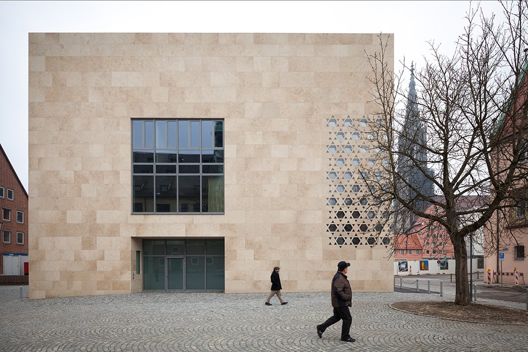 A freestanding, cuboid structure, the synagogue is signifcantly lower and more compact than its neighbors.  Photo 3 of 21 in You Won't Believe That These Incredible Modern Buildings are Chapels and Synagogues