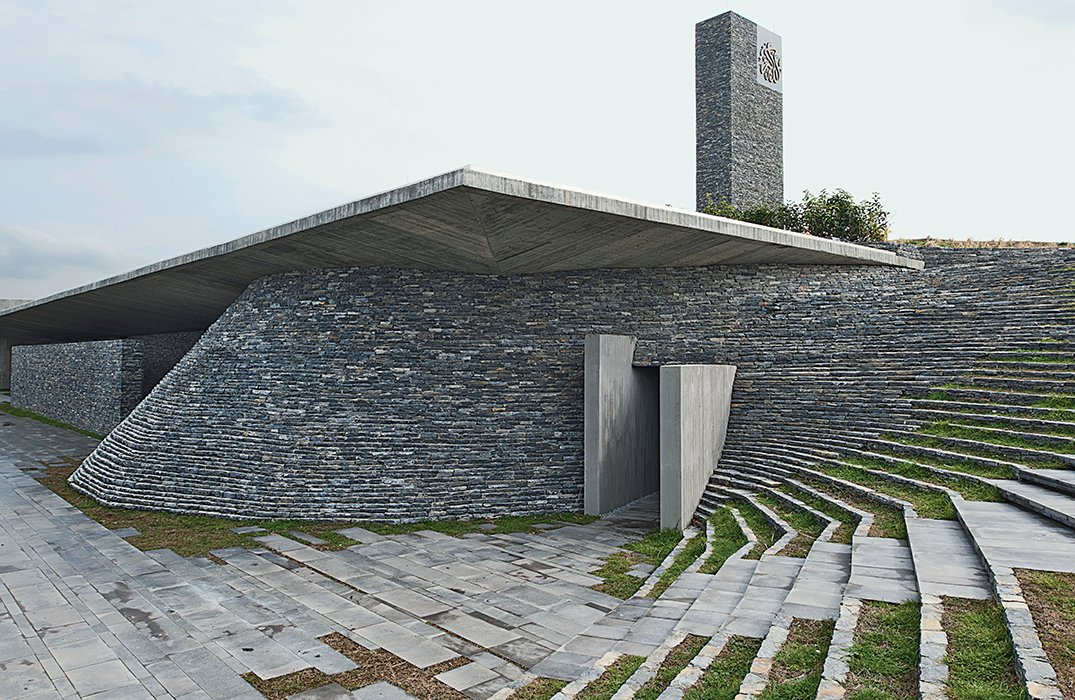 Emre Arolat's 2012 design for the Sancaklar Mosque outside Istanbul challenges the Turkish capital's ubiquitous soaring domes and patterned minarets. Instead, the firm built the 13,000-square-foot mosque into the side of a hill and clad it in natural stacked slate.  Photo 14 of 21 in I Love Modern Architecture from You Won't Believe That These Incredible Modern Buildings are Chapels and Synagogues