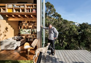 Oriented to absorb the afternoon sun, floor-to-ceiling doors comprise two-thirds of the home's west-facing walls, which open to an elevated deck overlooking Island Bay. Combined with extra-thick building insulation, this passive element provides sufficient heating for the home, even during winter months—a true feat given the region's cold seasonal winds.