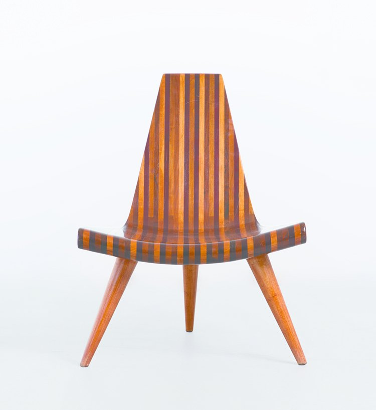 Striated shades of wood make up Brazilian designer Joaquim Tenreiro's three-legged chair from 1947.  Photo 2 of 8 in Discover Midcentury Modern Masterpieces from Brazil, Mexico, and Venezuela