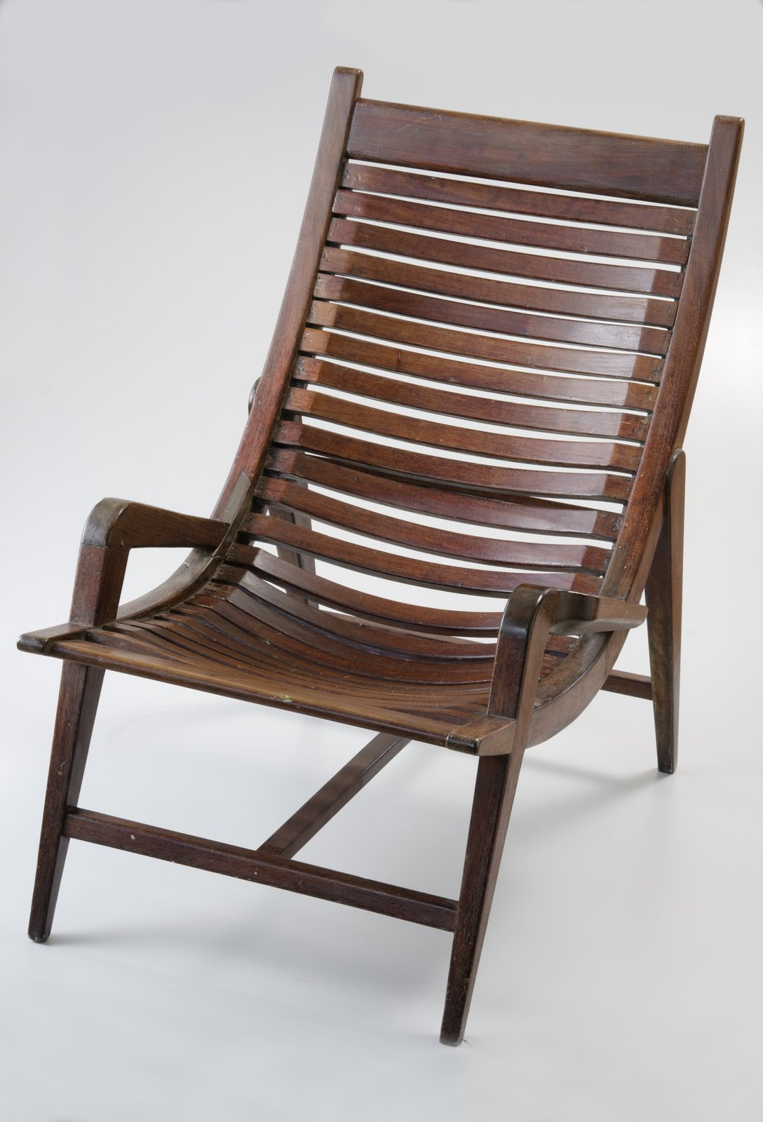 This prototype fo Venezuelan designer Miguel Arroyo's Butaque Pampatar chair was made from painted mahogany and cedar in 1953.  Photo 4 of 8 in Discover Midcentury Modern Masterpieces from Brazil, Mexico, and Venezuela