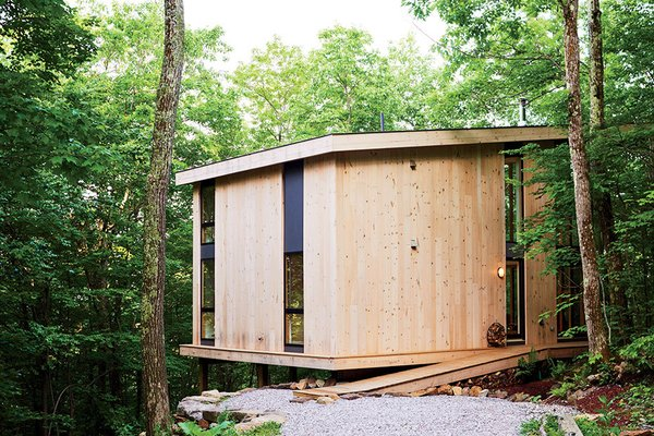 Those costs were partially recouped by using knotted pine planks for the exterior. Tagged: Exterior, Cabin Building Type, and Wood Siding Material.  Photo 61 of 101 in 101 Best Modern Cabins