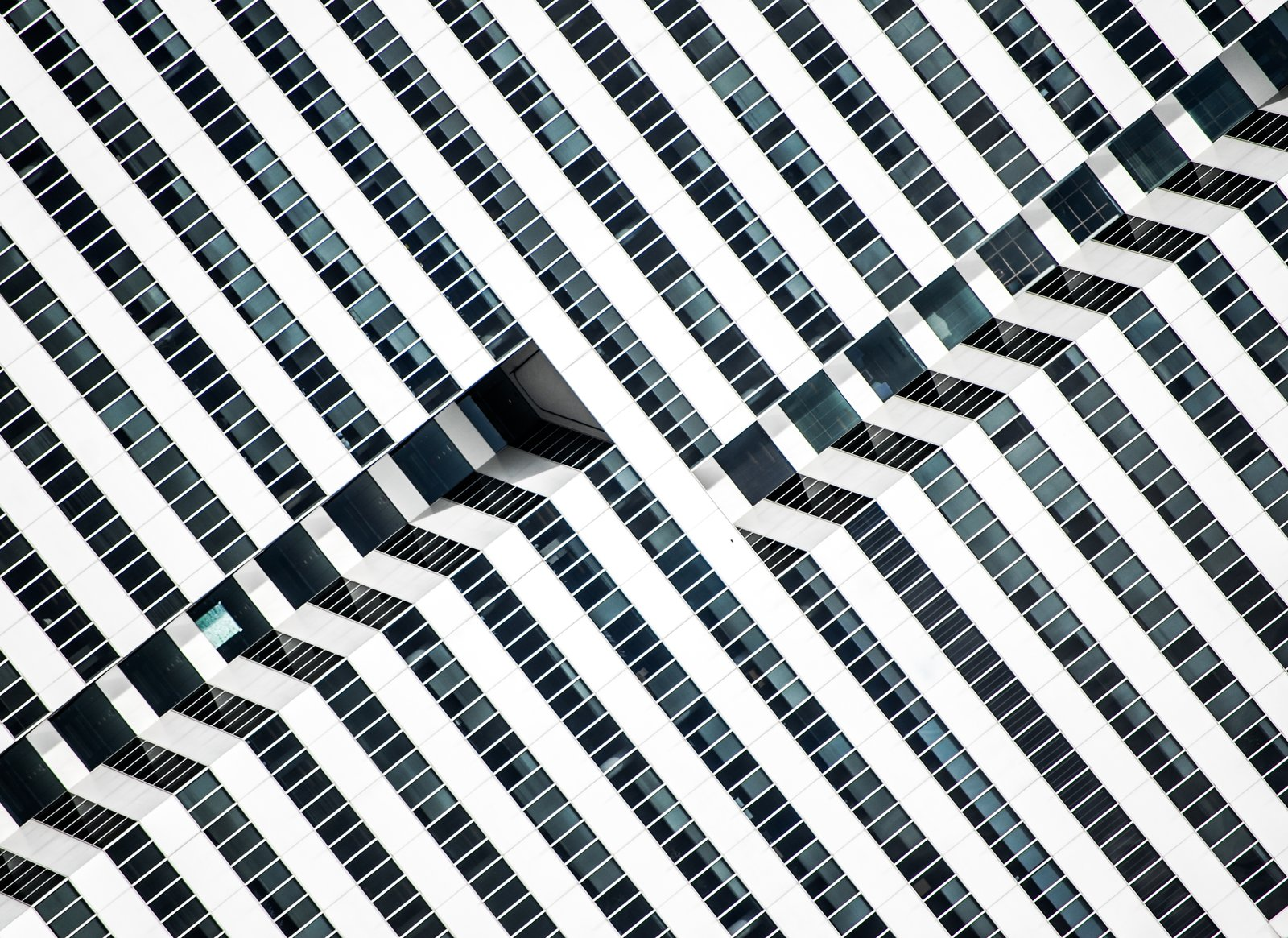 "Hypnotic, 2014. ""The saturated facade of this late-modernist 1981 office building in Houston, Texas, exposes the inner paths of its elevators, outlining the dramatic black-and-white lines with glass and aluminum,"" notes Olic.  Photo 3 of 16 in Nikola Olic's Dizzying Architectural Photography from Dizzying Architectural Photography"