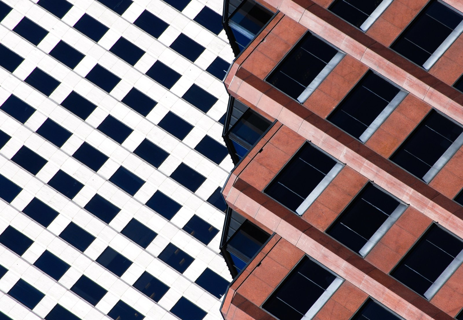 "Ripped, 2014. ""The angled top floors of this dark red office building in New Orleans, Louisiana, provide an interesting collage with the white building a few blocks down the street,"" says Olic. Combining the two is a simple photographic idea of a structure ripped into two distinct parts.""  Photo 7 of 16 in Nikola Olic's Dizzying Architectural Photography from Dizzying Architectural Photography"