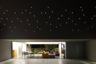The plexiglass tube's reverse lighting scheme emulates a starry sky above the patio when the interior is lit up at night.