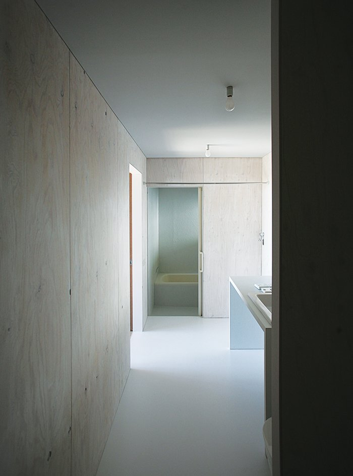 Bath Room, Ceiling Lighting, and Drop In Sink Most of the house is oriented toward the glass curtain wall overlooking the town of Odawara, save for private areas like the shared bathroom.  Photo 4 of 8 in Japanese Home Among the Trees Uses Bookshelves and Glass for Walls