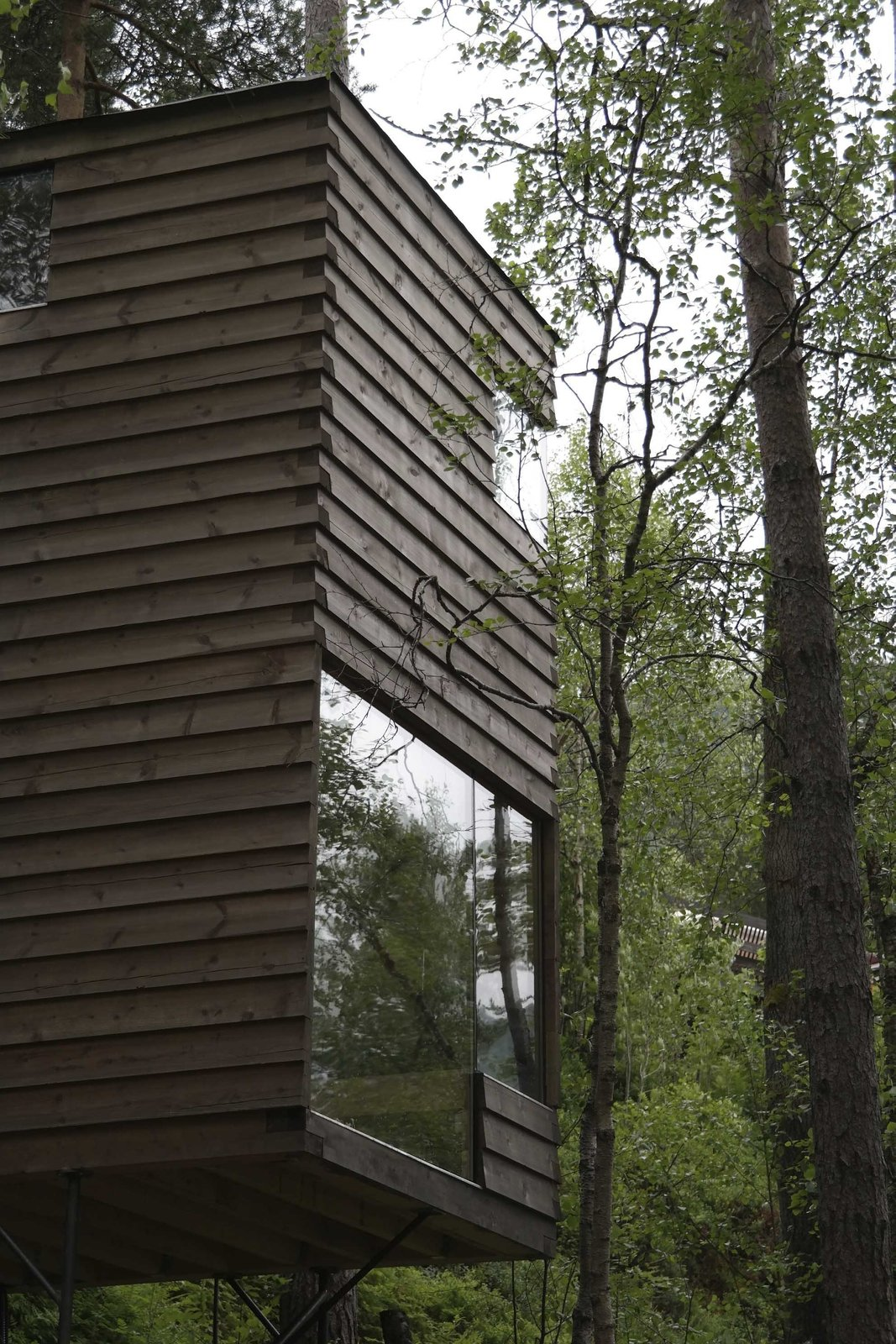 Exterior, Cabin Building Type, Wood Siding Material, Glass Siding Material, and Flat RoofLine Windows are punctuate the façades of the new cabins at unexpected but strategic locations in order to frame and maximize views.  Photo 5 of 8 in Rustic Cabins Comprise This Impossibly Idyllic Hotel in Norway