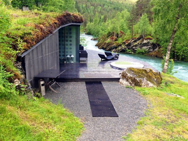 The hotel's spa space is set right into the banks on the rushing Valldola. The turf roof seems like a contemporary conceit but in fact is a reference to ancient Scandinavian tradition of sod roofs.