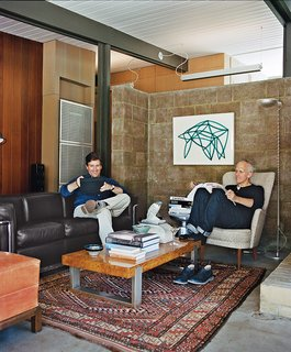 For their A. Quincy Jones house in Los Angeles, architect Bruce Norelius and his partner, Landis Green, retained and restored core elements, such as the living room's redwood paneling and concrete-block wall.