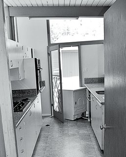 Prior to the renovation, the kitchen had a cramped midcentury style.