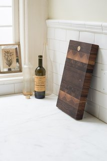 Many of the pieces are made by local craftspeople, like this black walnut cutting board by Oakland-based Jacob May.