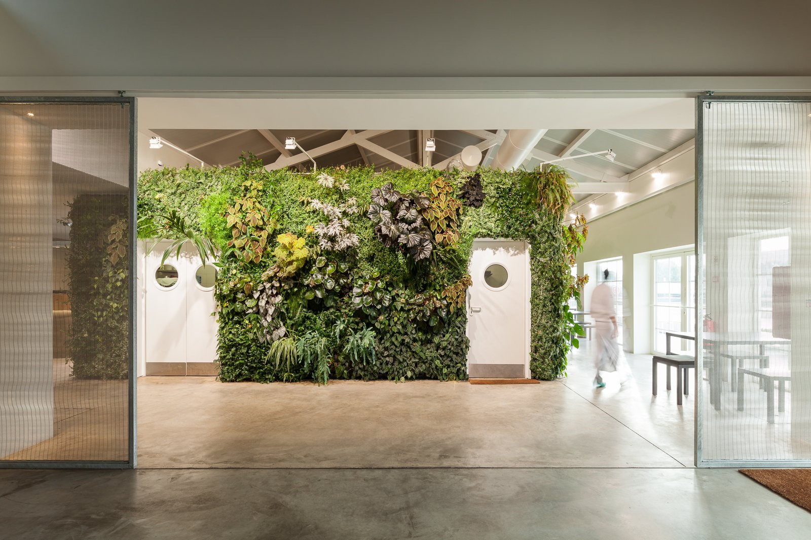 Doors, Interior, Metal, and Sliding Door Type Overall, the plant wall covers over 1,200 square feet of surface area.  Photo 3 of 6 in Vertical Gardens Spruce Up a Dusty Monument