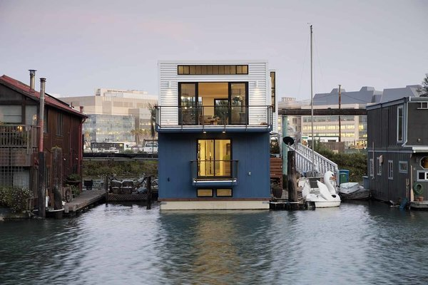 """Like a Loft on Water - Photo 1 of 9 - """"By creating high ceilings with large windows, the feeling is all about space and light,"""" says architect Robert Nebolon, principal of Berkeley firm Robert Nebolon Architects. The 2,100-square-foot floating house was built on land in six months before settling into its final location in Mission Creek."""