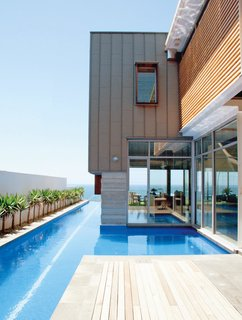8 of the Best Modern Pools to Dream of Before the End of Summer - Photo 4 of 8 - Outside of Sydney in Maroubra, Australia, Wright Feldhusen Architects designed a home with a large, irregularly-shaped lap pool that extends to the ocean beyond the property.