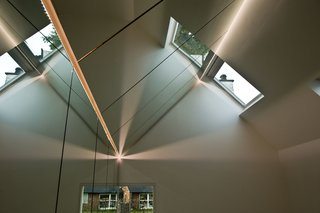 Because of the mirrored interior, the VELUX Group placed the roof windows towards the northeast in an effort to minimize any direct light, and hence uncomfortable heat, within the studio.