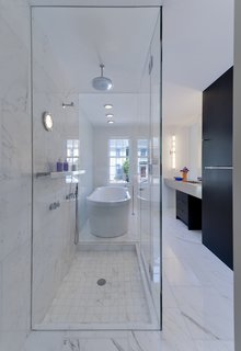 Italian Calacatta Gold marble tiles in the bathroom match an equally pristine Duravit bathtub. Vola fittings were installed in the shower.