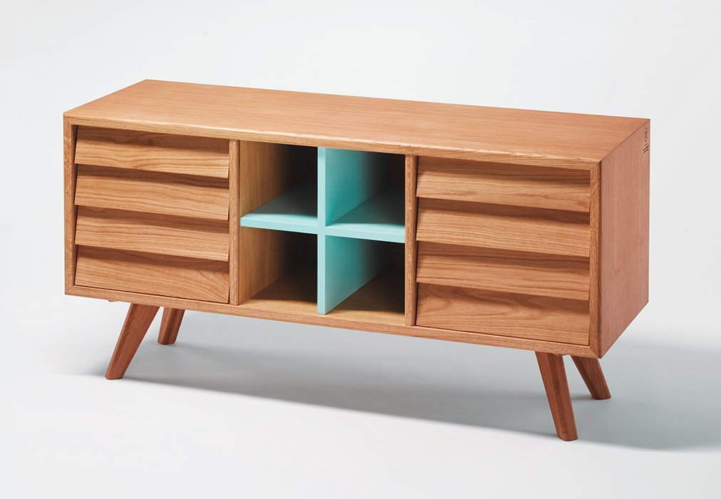 The drawer fronts of the sideboard from the Remix collection were modeled after Scandinavian sailboats.  Photo 5 of 14 in Modern Furniture Designer Continues Her Family Tradition