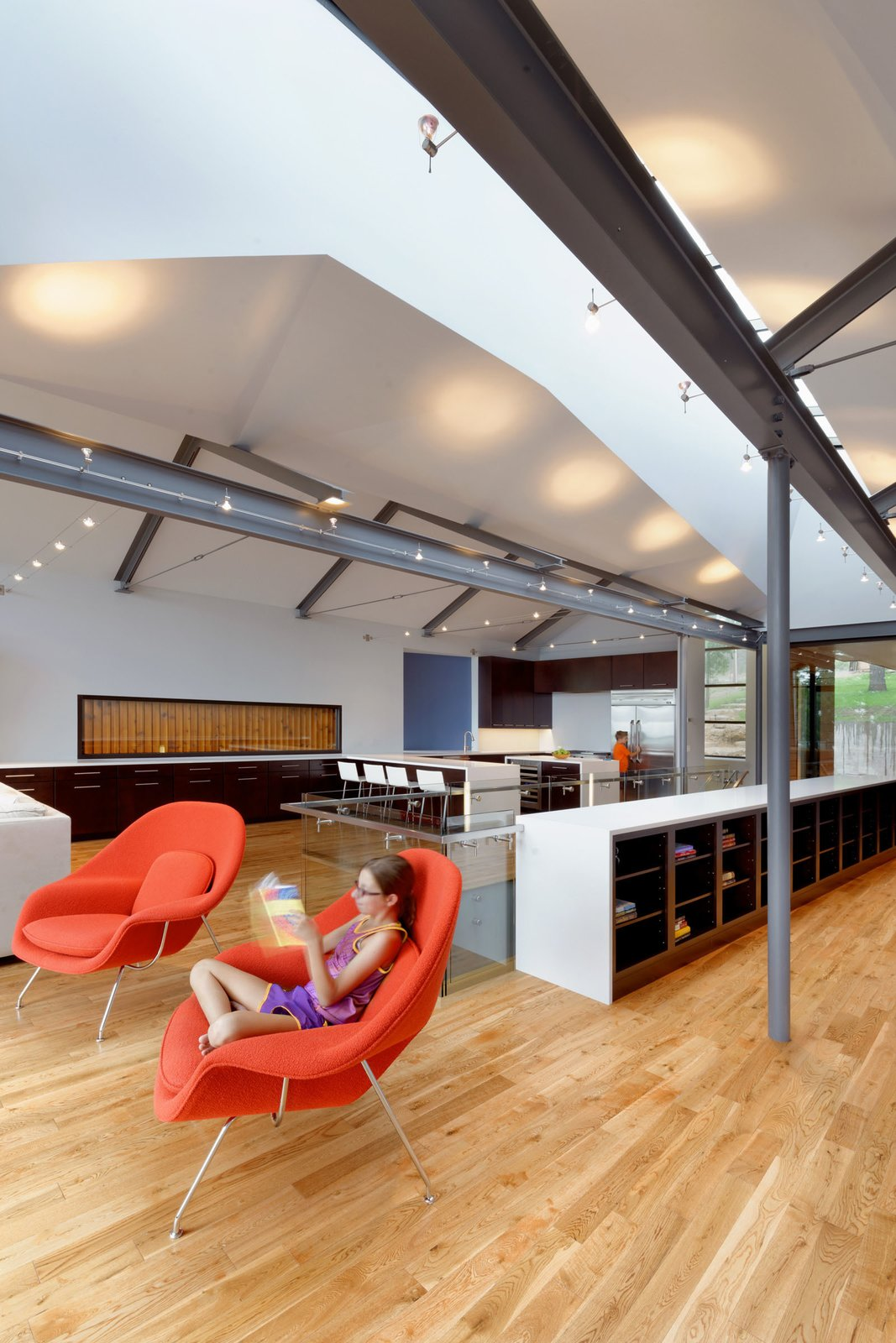The floors are prefinished tongue-and-groove oak, a common species in the area. The cherry casework is Kaffe by KraftMaid.  Photo 4 of 9 in Modern Lake House in Missouri