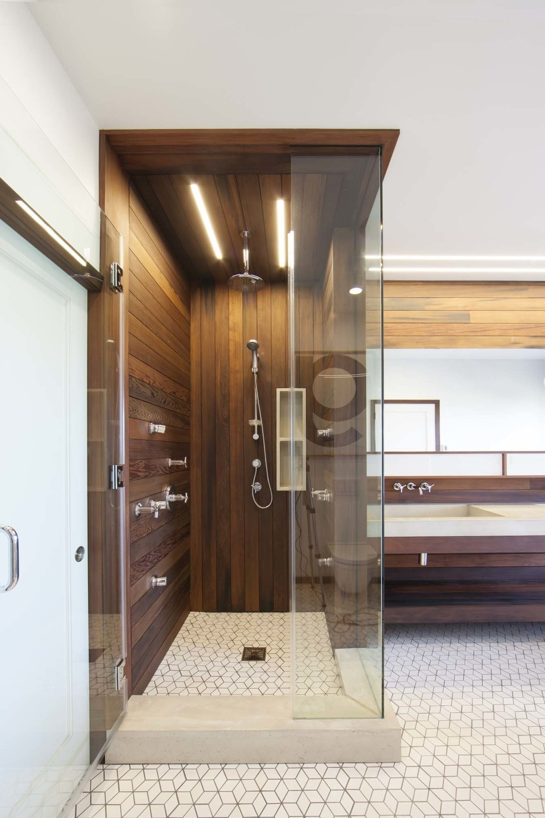 Bath Room and Enclosed Shower Lighting in the bathroom is provided by San Francisco-based Aion LED's modular fixture system. The linear lighting mimics the redwood siding.  Photo 10 of 10 in 10 Best Modern Showers to Inspire Your Bathroom Renovation from Warm Wood Modern Bathroom Renovation in San Francisco