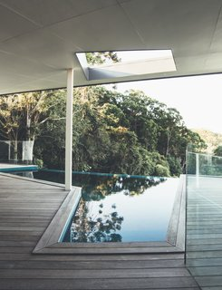 The geometric pool also captures views of the lush landscape.