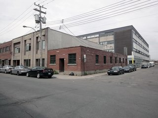 """The old shop, which they purchased in 2009, is located in Mile Ex, an up-and-coming neighborhood in Montreal. The renovation required a great deal of permitting and rezoning, and during the long wait they """"let the pot stew with their ideas,"""" according to Chabauty. They decided to keep the facade simple to preserve its character."""