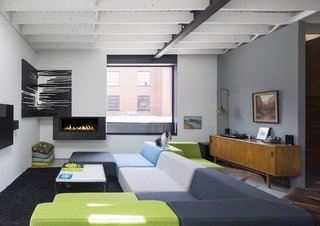The open living space showcases the bright, streamlined furniture pieces of Chabauty's own creation (apart from a few vintage pieces, the bulk of the furniture in the home is custom-made).