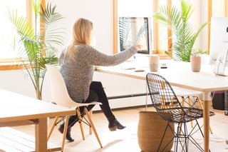A Calico team member is shown working in the company's Brooklyn-based creative studio.