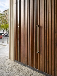 The Museum for Architectural Drawing in Berlin, designed by Russian firm SPEECH Tchoban & Kuznetsov, has a wooden door that mimics the structure's textured concrete exterior.