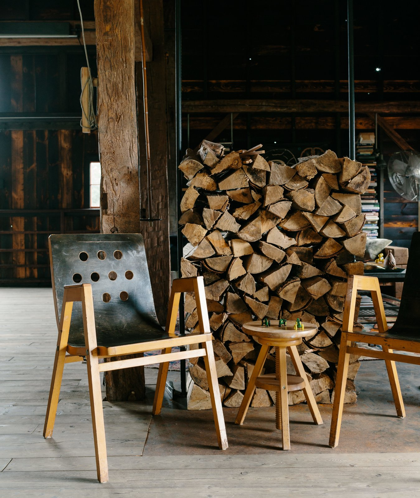 """Living Room, Chair, and Light Hardwood Floor Vintage bent plywood stacking chairs by Roland Rainer are purposeful and can be moved to suit any situation.  Photo 8 of 13 in A Passive House and """"Sauna Tower"""" Join a 19th-Century Barn in the Hudson Valley"""
